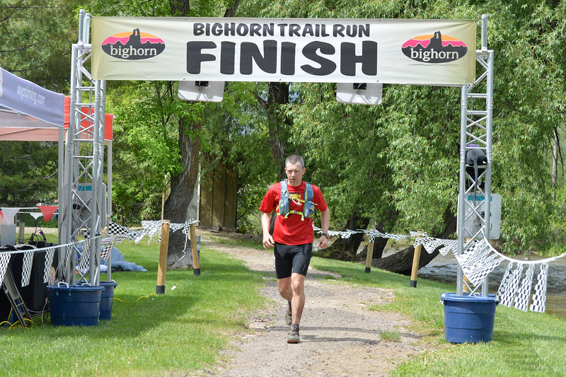 Ryan Patterson | The Sheridan Press<br /> Adam Schwartz-Lowe finishes the 100-mile race during the Bighorn Mountain Wild and Scenic Trail Run at Scott Bicentennial Park in Dayton, Saturday, June 15, 2019. Schwartz-Lowe hails from Duluth, Minnesota, and took 15th overall in the race.