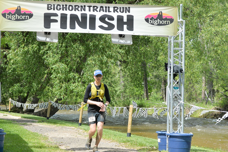 Ryan Patterson | The Sheridan Press<br /> Chris Coolican crosses the finish line during the Bighorn Mountain Wild and Scenic Trail Run at Scott Bicentennial Park in Dayton, Saturday, June 15, 2019. Coolican is from Calgary, Alberta, Canada, and placed 13th in the 100-mile race.