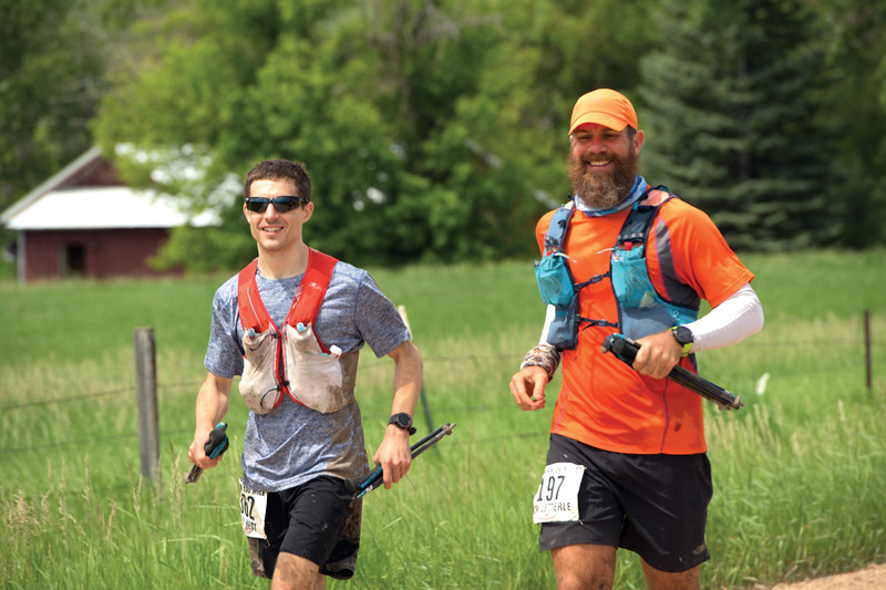 Matthew Gaston | The Sheridan Press<br>Cody West, left, and Ken Letterle run the final two and half miles of the 100 mile Bighorn Trail Run Saturday, June 15, 2019.