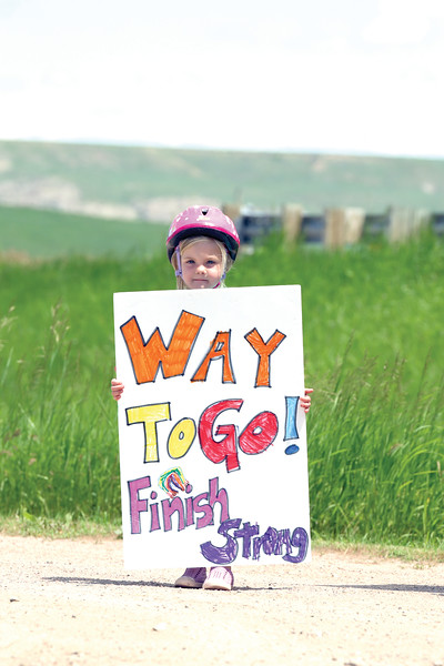 Matthew Gaston | The Sheridan Press<br>Four-year-old Charlie Smith holds a sign to show her support for participants in the Bighorn Trail Run in Dayton Saturday, June 15, 2019.