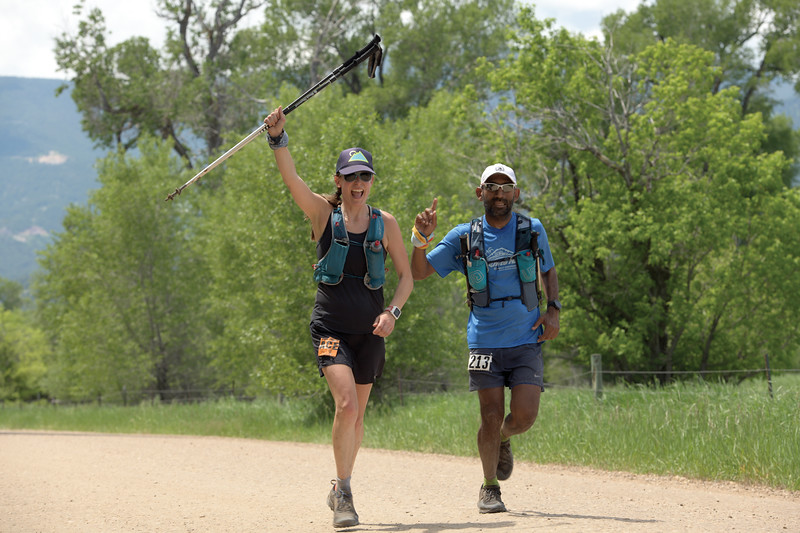 Matthew Gaston | The Sheridan Press<br>Sudheer Maremanda, right, from Bellvue, Washington runs along side a pacer with one mile left of Maremanda's 100 mile run at the Bigorn Trail Run Saturday, June 15, 2019.