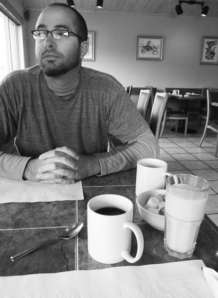 Adam waits for breakfast at the AlCan Motel