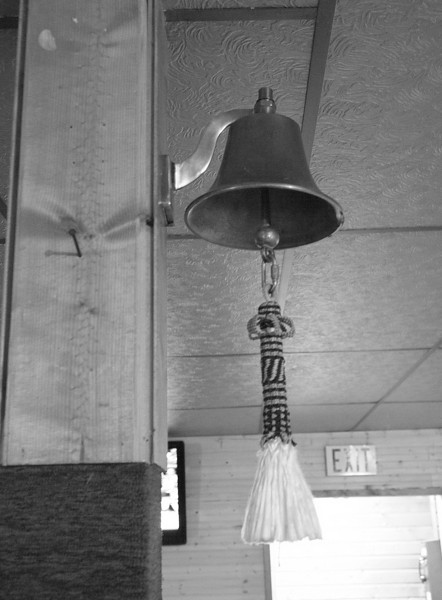 bar bell at Haines Junction- don't ring it unless you want to buy everyone a drink...