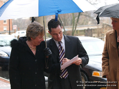 Bethlehem, PA, 03-19-2008: Bethlehem Mayor John Callahan's  administrative assistant, Louise Kelchner, left and secretary, Sherry Flanagan, pause on Main Street with the mayor to review his speech at the Hotel Bethlehem this afternoon during the campaign stop by former President, Bill Clinton. (Photo by: Tim Wynkoop)