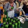 Billerica's annual Health & Wellness Fair at Billerica Elks. Edie Baro of Billerica picks up a reusable bottle and checks out other water saving products being given away at the Billerica Water Department table. (SUN/Julia Malakie)