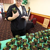 Billerica's annual Health & Wellness Fair at Billerica Elks. Tammy Hannon of Billerica picks out a free marigold from Griggs Farm for her mother.  (SUN/Julia Malakie)