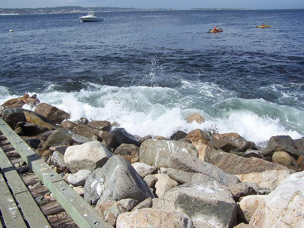 Intermittent big waves roll over boat ramp on Saturday.