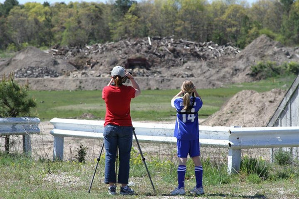 "Some teams members won't miss Bird-a-thon no matter how busy their schedules. First soccer, then birding or is it first birding, then soccer...   <font size=""2"">Photo by Paul Keleher</font>"