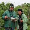 """<font size=""""4""""><strong>To help identify birds, team members turned to their trusty field guides...</strong></font>  Photo courtesy of Cathy Maher"""