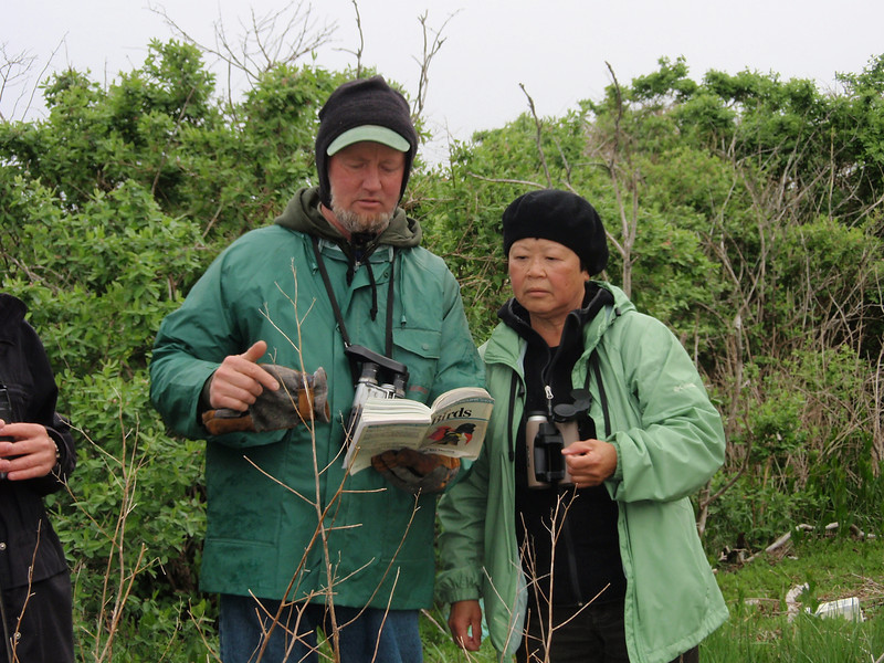 "<font size=""4""><strong>To help identify birds, team members turned to their trusty field guides...</strong></font>  Photo courtesy of Cathy Maher"