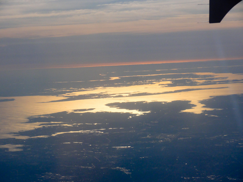 Shots of the Chesapeake Bay and its tributaries with mid-morning sunlight glinting off the water. Lots of low-level haze (pollution) causing the red-orange hues