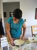 Mariyam spreading the dough for the leek mushroom quiche.