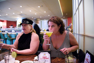 Dahli & Crystal. Crystal trying the Pickle Martini.