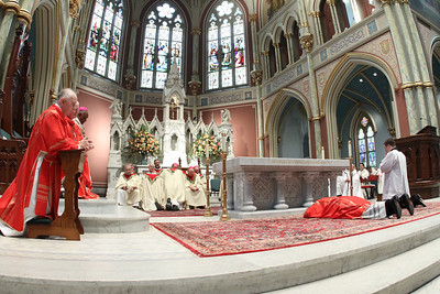 Bishop-elect Gregory John Hartmayer prostrates himself before the altar during the Litany of the Saints.  (Page 3, October 27, 2011 issue)