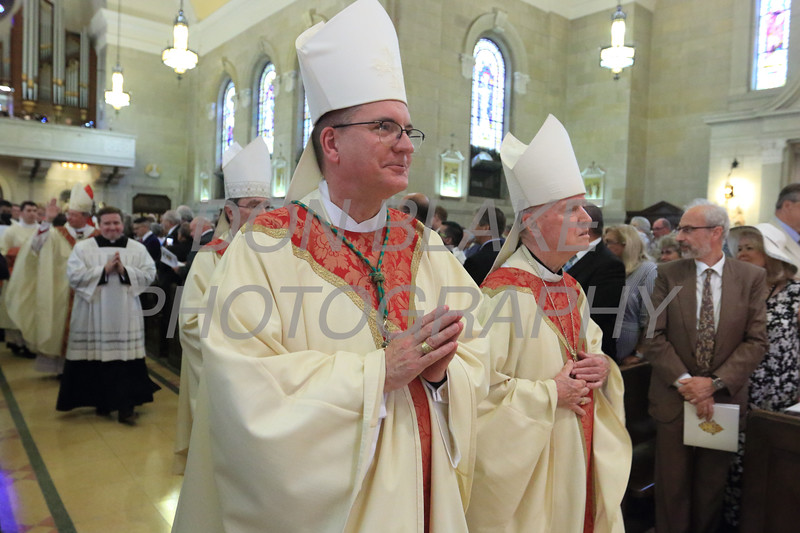 Bishop John Barres, Rockville Centre, NY and Bishop Farncis Malooly process in during Bishop William Koenig's Ordination Mass at St. Elizabeth Church, Tuesday, July 13, 2021. Photo/Don Blake