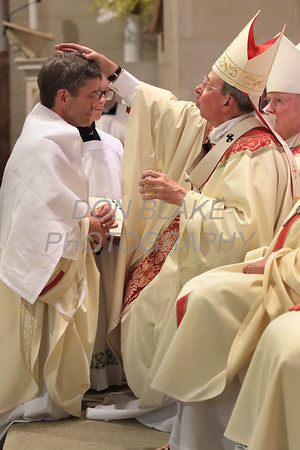 Bishop William Koenig the new Bishop of the Diocese of Wilmington is anointed by Archbishop William E. Lori - Archdiocese of Baltimore, MD during his Ordination Mass at St. Elizabeth Church, Tuesday, July 13, 2021. Photo/Don Blake