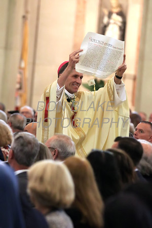 Bishop William Koenig the new Bishop of the Diocese of Wilmington holds up the Apostolic Mandate for everyone to inspect during his Ordination Mass at St. Elizabeth Church, Tuesday, July 13, 2021. Photo/Don Blake