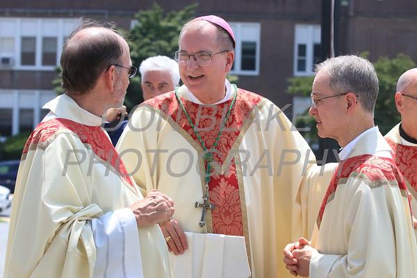 Bishop John Barres, Rockville Centre, NY talks with Msgr. John Hopkins and Fr. Charles Dillingham before Bishop William Koenig Ordination Mass at St. Elizabeth Church, Tuesday, July 13, 2021. Photo/Don Blake