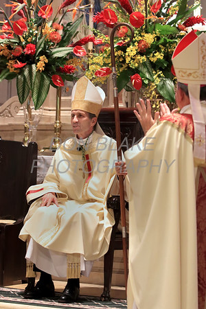Bishop William Koenig the new Bishop of the Diocese of Wilmington sits in his chair as Bishop of Wilmington for the first time during his Ordination Mass at St. Elizabeth Church, Tuesday, July 13, 2021. Photo/Don Blake