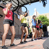 Don Knight | The Herald Bulletin<br /> The Anderson Steppers perform during the Black Expo Talent Show on the stage at Town Center Park on Friday.