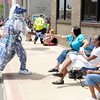 Don Knight | The Herald Bulletin<br /> Colts Super Fan Michael Hopson greats people along the Black Expo parade route on Saturday.