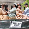 Don Knight | The Herald Bulletin<br /> Freetown Village reenactors sing as they ride in a horse drawn wagon during the Black Expo parade on Saturday.