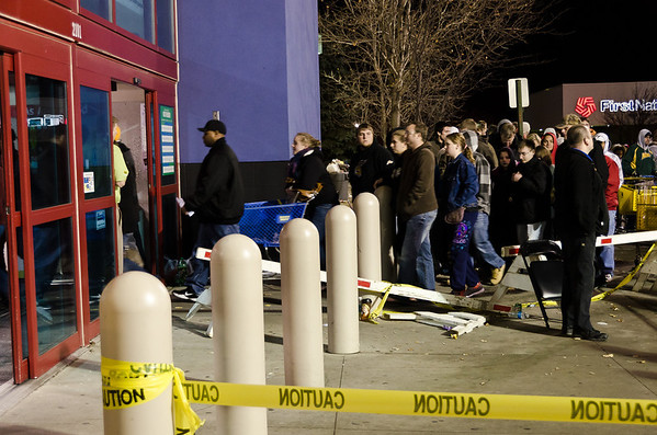The line to get in was wrapped around to the back of the building. Limited number of people were in Best Buy at a time. While we were there, one fight broke out.