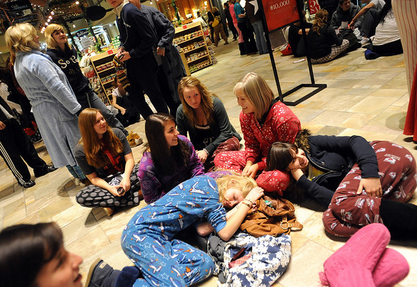 "Brenna Dowdy, bottom left, naps on Emily Dattori, while Kim Dietz, makes a pillow out of Jenna Jarvis. The group was waiting for the 6 a.m. pajama breakfast.<br /> Black Friday shoppers hit the stores by 5 a.m. at Flatiron Crossing in Broomfield.<br /> For a more photos of Black Friday, go to  <a href=""http://www.dailycamera.com"">http://www.dailycamera.com</a>.<br /> Cliff Grassmick / November 26, 2010"