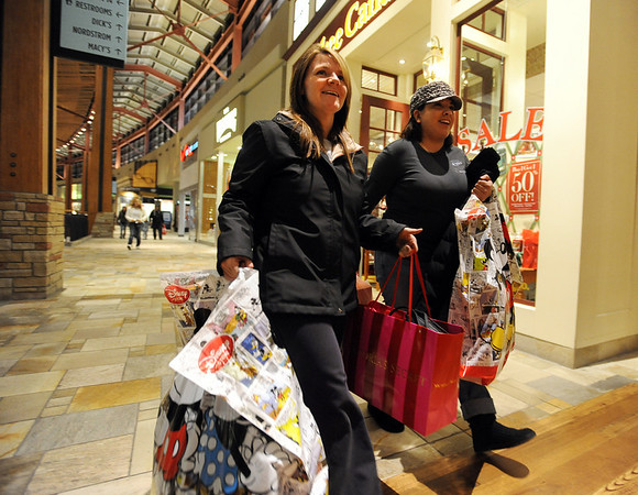 """Marlo Vigil, left, and Luciana Ruiz, both of Thornton, were weighted down with bags before 6 a.m.<br /> Black Friday shoppers hit the stores by 5 a.m. at Flatiron Crossing in Broomfield.<br /> For a more photos of Black Friday, go to  <a href=""""http://www.dailycamera.com"""">http://www.dailycamera.com</a>.<br /> Cliff Grassmick / November 26, 2010"""