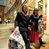 "Marlo Vigil, left, and Luciana Ruiz, both of Thornton, were weighted down with bags before 6 a.m.<br /> Black Friday shoppers hit the stores by 5 a.m. at Flatiron Crossing in Broomfield.<br /> For a more photos of Black Friday, go to  <a href=""http://www.dailycamera.com"">http://www.dailycamera.com</a>.<br /> Cliff Grassmick / November 26, 2010"