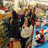 "Corina Cardenas, left, and Aliyah Vigil, wait for the next checker at the Old Navy store.<br /> Black Friday shoppers hit the stores by 5 a.m. at Flatiron Crossing in Broomfield.<br /> For a more photos of Black Friday, go to  <a href=""http://www.dailycamera.com"">http://www.dailycamera.com</a>.<br /> Cliff Grassmick / November 26, 2010"