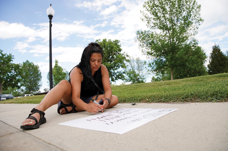 Matthew Gaston | The Sheridan Press<br>Former Miss Wyoming Beck Bridger makes a sign for the Black Lives Matter Solidarity Protest in Sheridan Friday, June 5, 2020.