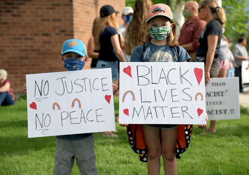 Allayana Darrow | The Sheridan Press<br /> Judah and Kamari Barth hold signs outside the Sheridan Fulmer Public Library Friday, June 5, 2020.