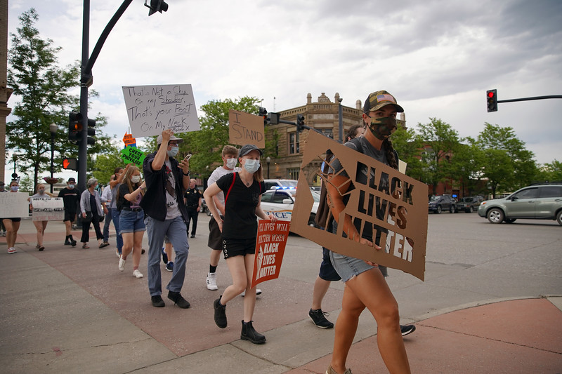 Matthew Gaston | The Sheridan Press<br>Black Lives Matter protesters cross the intersection at Alger and Main Street in Sheridan headed toward the courthouse Friday, June 5, 2020.
