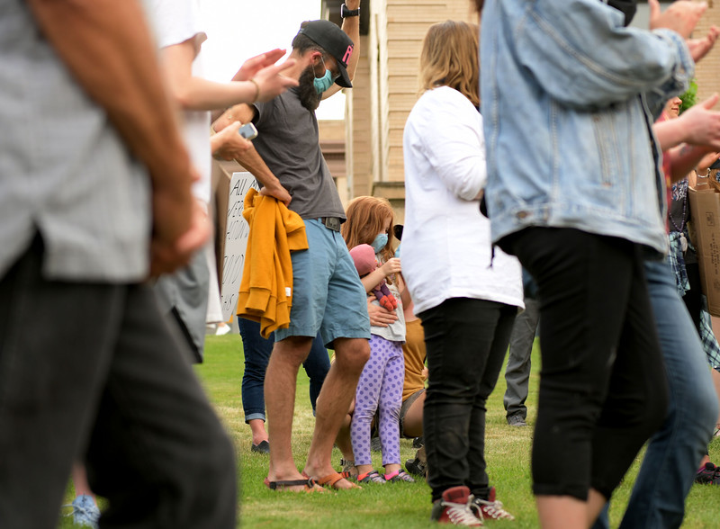 Allayana Darrow | The Sheridan Press<br /> Sheridan Community Land Trust Executive Director Brad Bauer stands with his step-daughter on the lawn of the Sheridan County Courthouse Friday, June 5, 2020.