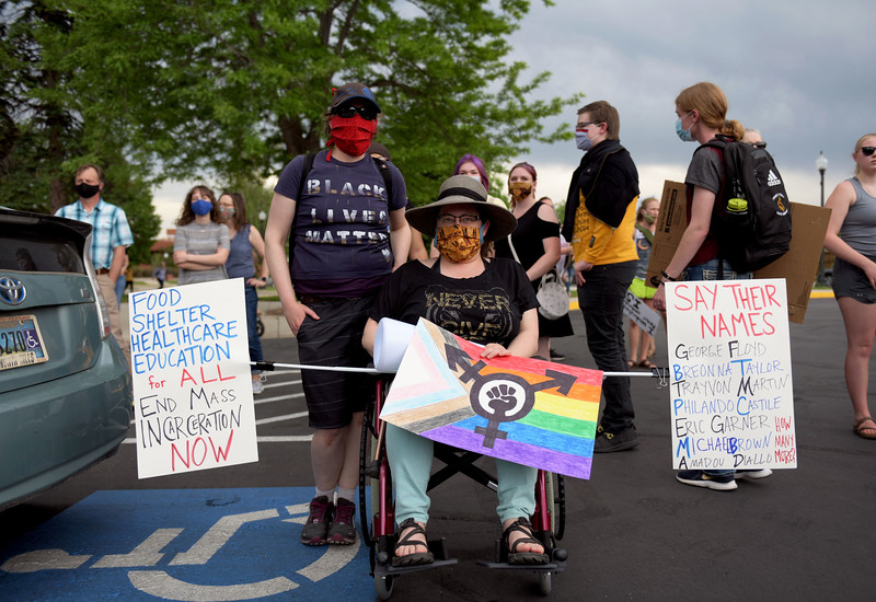 Allayana Darrow | The Sheridan Press<br /> Two protesters, who requested to remain unnamed, prepare to join a march from the Sheridan Fulmer Public Library to the Sheridan County Courthouse Friday, June 5, 2020.
