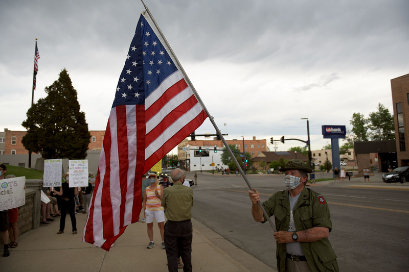 Allayana Darrow | The Sheridan Press<br /> A protester waves an American flag over the crowd at the Sheridan County Courthouse Friday, June 5, 2020.