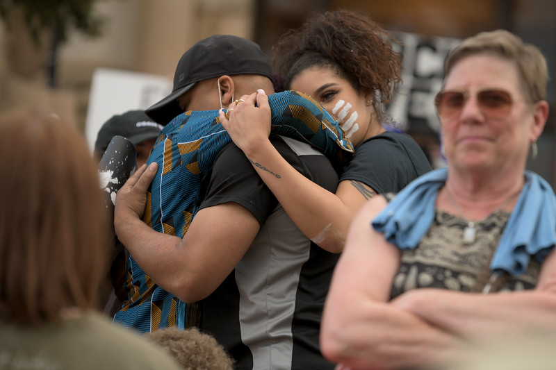 Matthew Gaston | The Sheridan Press<br>Kenneth Grant, left, and Naomi Morales, right, hug Derrick Linzy after Linzy gave a passionate speech during the Black Lives Matter Solidarity Protest in Sheridan Friday, June 5, 2020.