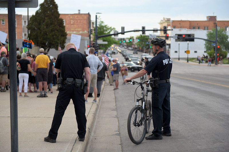 Allayana Darrow | The Sheridan Press <br /> Sheridan Police Department Lt. Tom Ringley and Sgt. Jerry Rasmussen monitor a peaceful protest Friday, June 5, 2020.