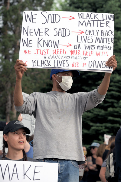 Matthew Gaston | The Sheridan Press<br>John McCrary holds a sign that explains the Black Lives Matter slogan during the Black Lives Matter Solidarity Protest Friday, June 5, 2020.