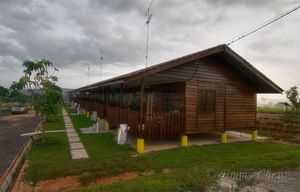 The longhouse wooden chalets come with air-conditioning units, LCD TV, heater and mini fridge. The rooms are interconnected too. Garbage bags are provided neatly just below the verandah. As one may notice, the high antennas can receive TV signals from Singapore. Right in front is parking space but with a dead end, so you may want to reverse in when parking. This photo is from my previous visit.