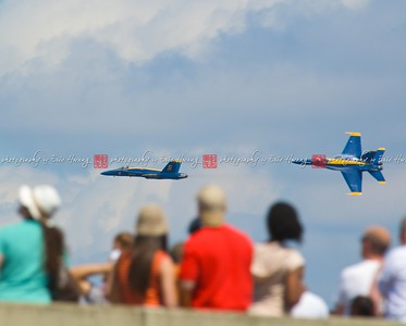 Jets performing aerobatics over spectators