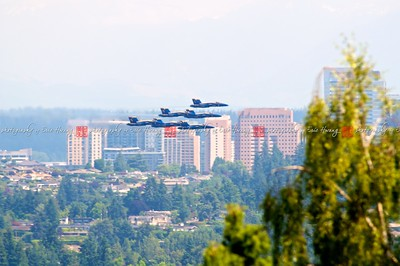 Jets flying low in formation over building