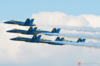 Blue Angels in tight formation in the clouds