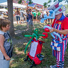 Eight-year-old Kamryn Williams of Gainesville waits patiently as Skip the Balloon Guy makes him a fishing rod and a red-fish-blue-fish. Fran Ruchalski/Palatka Daily News