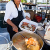 Chlor Cross cooks up some tasty boiled crab as she prepares for the hungry crowds as they make their way to the riverfront for the Blue Crab Festival on Friday afternoon. Fran Ruchalski/Palatka Daily News