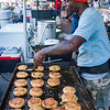Victor Jones did his best to keep up with the demand for what he boasted were the biggest and best crab cakes in all of Florida at the Blue Crab Festival. Fran Ruchalski/Palatka Daily News