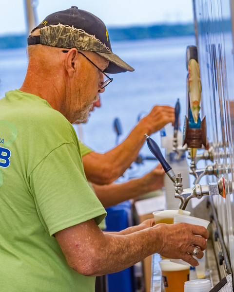 With the temperatures reaching scorching highs, Chuck Gauthier had both his hands filled trying to keep the beers flowing to waiting customers. Fran Ruchalski/Palatka Daily News