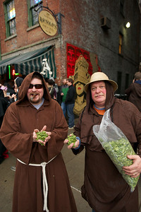 Chris Mitchell and Dan Listerman of Cincinnati throw hops onto the street in honor of Bockfest