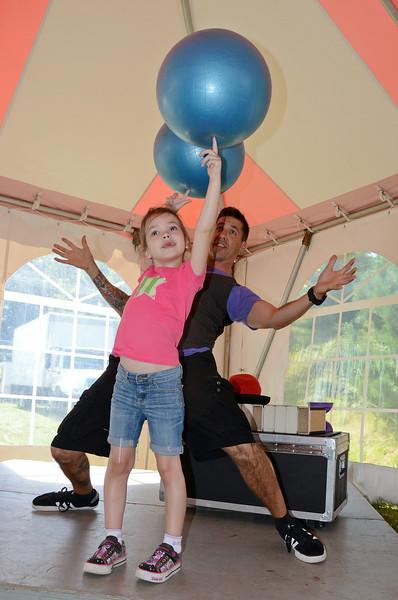 Chloe Steinborn, 5, of Hopkinton, performs a balancing act at the Bolton Fair on Saturday morning. SENTINEL & ENTERPRISE / Ashley Green